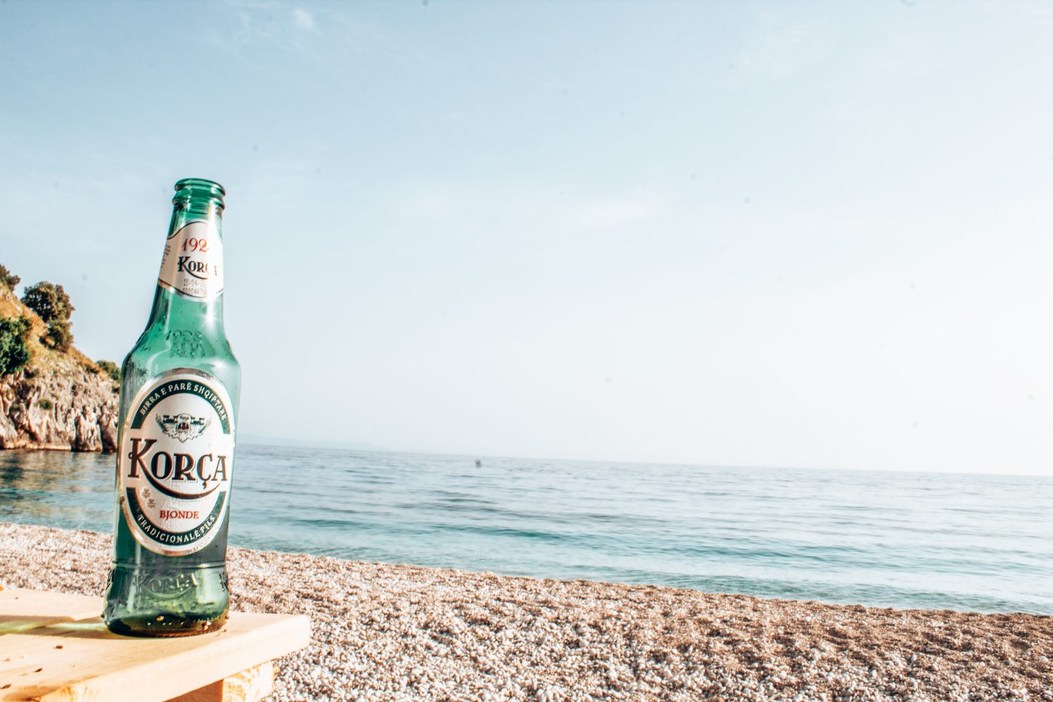 korca beer on the beach