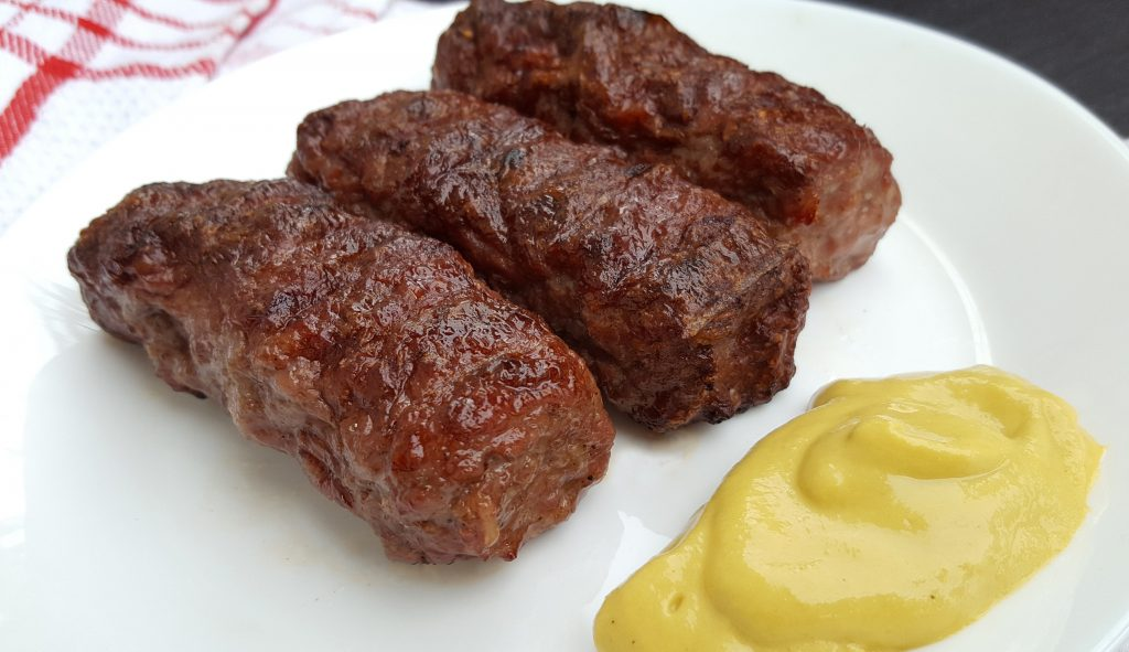 Meat rolls (mititei or mici ) traditional romanian food with mustard
